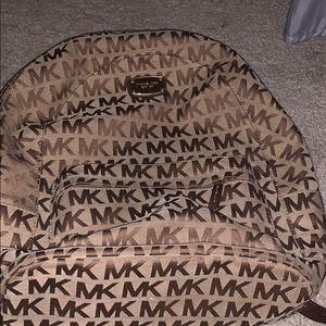 Michael Kors book bag.